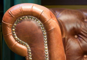 Close-up of an antique leather retro chair